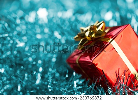 Christmas gift on blue defocused lights background - stock photo