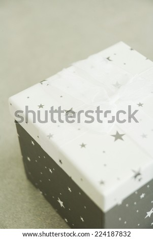 Christmas gift, on floor, close-up - stock photo