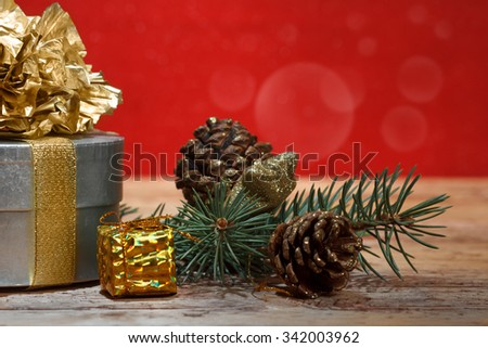 Christmas gift on wooden background - stock photo
