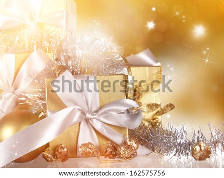Christmas gift over golden background