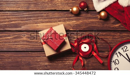 Christmas gift-ready for packaging on a wooden background