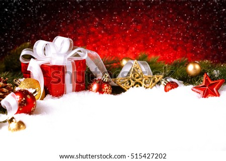 Christmas gift with decoration on snow. Studio shot