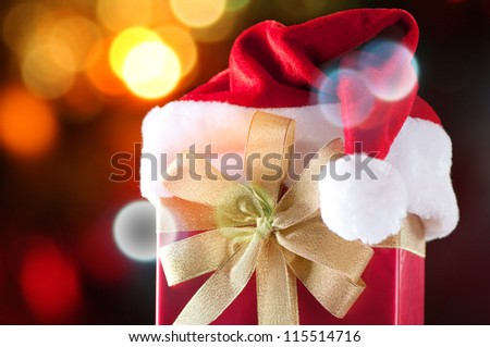 Christmas gift with defocused glittering lights background - stock photo