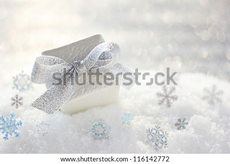 Christmas gift with snowflakes on snow