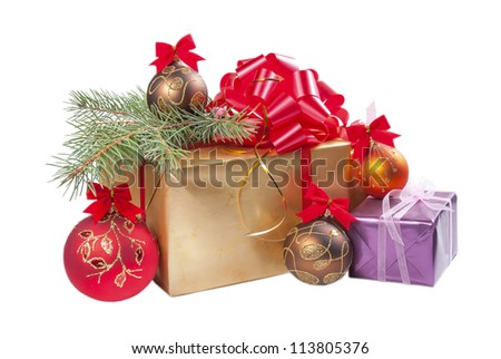 Christmas gifts and balls with fur-trees branch isolated on white background - stock photo