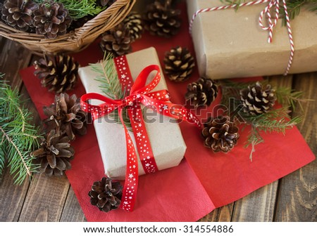 Christmas gifts and cones and on a wooden table. Christmas decoration. - stock photo