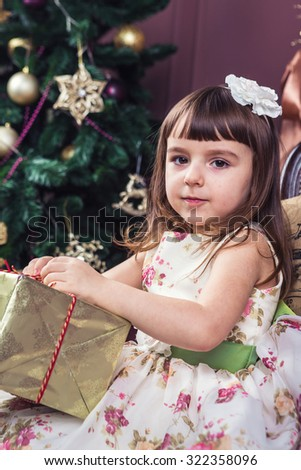 Christmas gifts and surprises. Girl opening a box. Merry Christmas and happy New Year! A series of photos