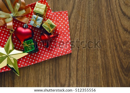Christmas gifts and vary of decoration on wood background