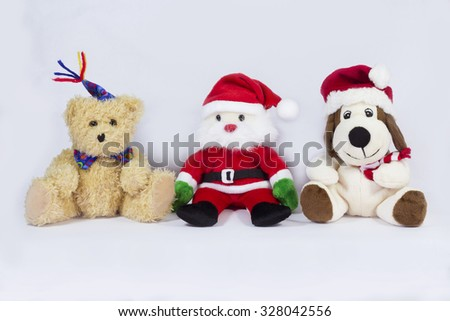 Christmas gifts / Brown teddy bear,Santa Claus,Beagle with  santa hat isolated on white background   - stock photo