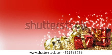 Christmas gifts in golden confetti on red background