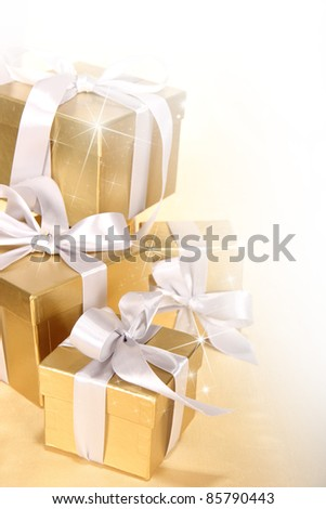 Christmas gifts in golden theme - stock photo