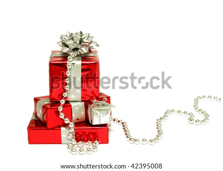 Christmas gifts isolated on white background - stock photo