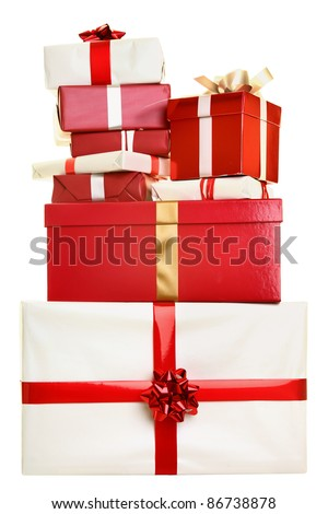 Christmas gifts isolated. Pile of christmas presents stacked isolated on white background. Red and white colors. - stock photo