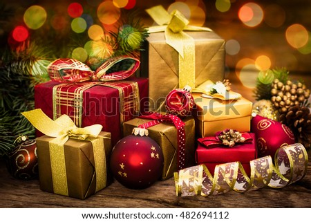 Christmas gifts on the wooden background