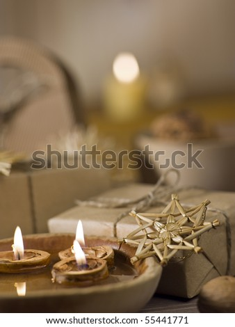 Christmas gifts still life with natural brown background - stock photo