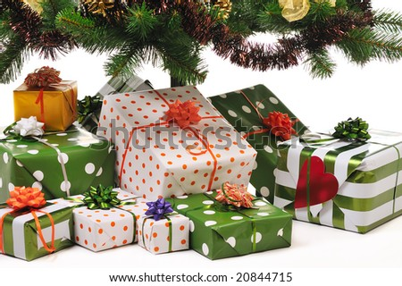 Christmas gifts under decorated fir tree - stock photo