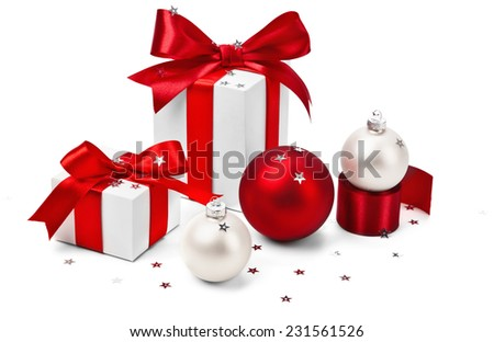Christmas gifts with red bows and balls isolated on white - stock photo