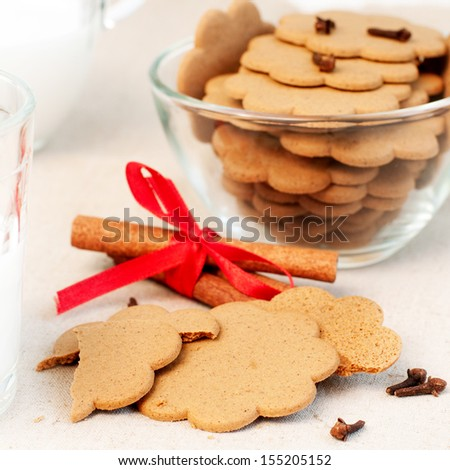 Christmas gingerbread, cloves and cinnamon sticks, selective focus