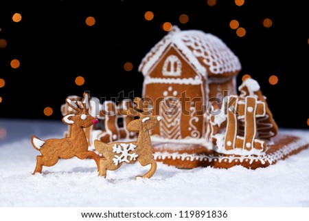 Christmas gingerbread cookie house and deers - holidays food setting - stock photo