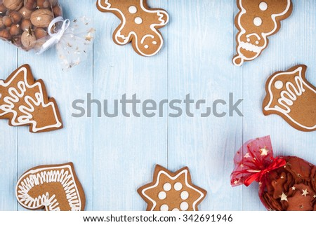 Christmas gingerbread cookies and nuts on blue wooden background