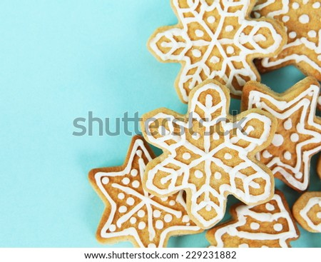 Christmas Gingerbread Cookies Border over Blue Background