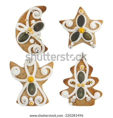 Christmas gingerbread cookies -  christmas tree, angel, moon, star -  isolated on white background, with PS paths. - stock photo