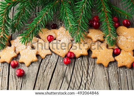 Christmas Gingerbread Cookies. Holiday concept decorated with Fir Tree and Cranberry, top view