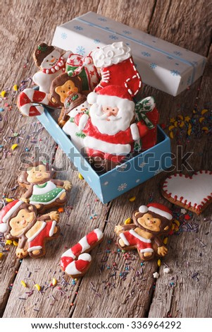 Christmas gingerbread cookies in a gift box on a table close-up. vertical top view - stock photo