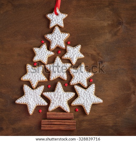 Christmas Gingerbread cookies in the shape of star on the wooden dark background - stock photo