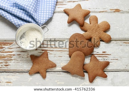 Christmas gingerbread cookies on a white wooden background - stock photo