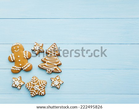 Christmas gingerbread cookies on the blue background. Viewed from above. - stock photo