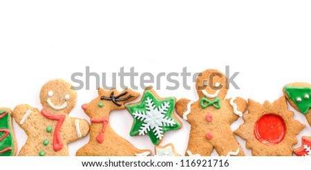 Christmas gingerbread cookies over white - stock photo