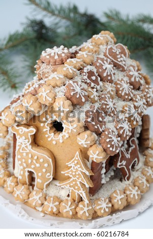 Christmas gingerbread house on white background. Shallow dof - stock photo