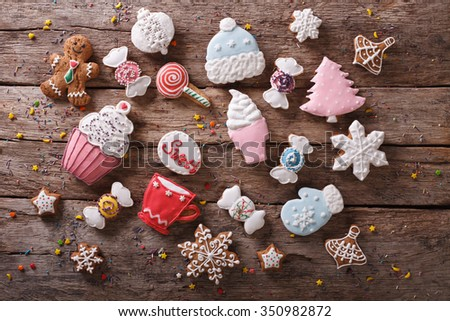 Christmas gingerbread in pastel colors on the table. Horizontal top view background - stock photo