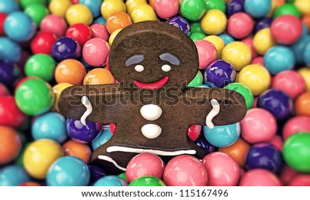 christmas gingerbread man playing with many gumballs