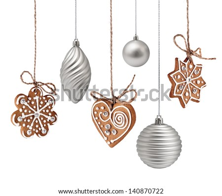 Christmas gingerbreads and glass decoration hanging isolated - stock photo