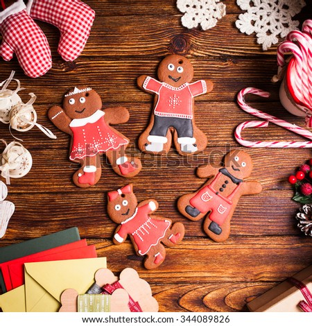 Christmas gingermen family on a wooden table - stock photo