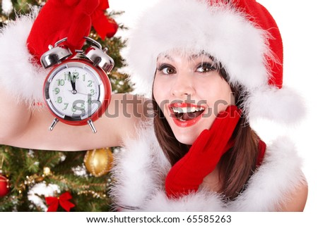 Christmas girl in santa hat holding stack  gift box.  Isolated. - stock photo
