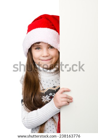 Christmas girl in santa helper hat with blank white board. isolated on white background - stock photo