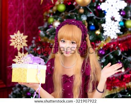 Christmas girl lolita sweet  Christmas tree - stock photo