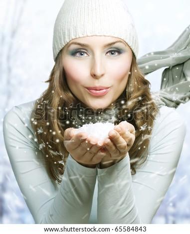Christmas Girl.Winter woman Blowing Snow - stock photo