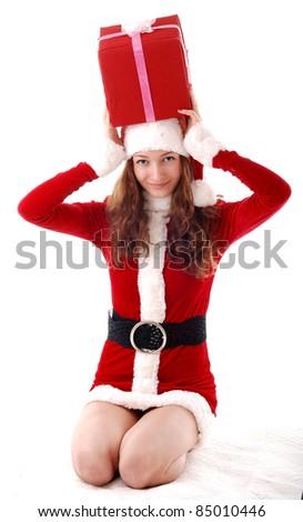 Christmas girl with a gift. - stock photo