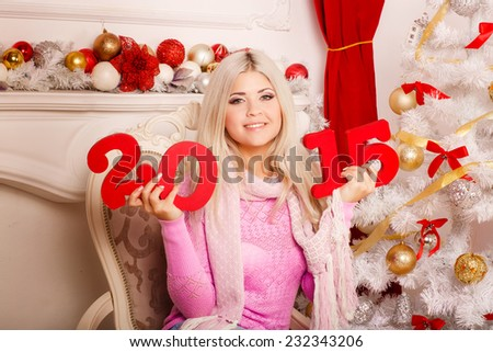 Christmas girl with gift boxes, x-mas winter happiness concept 2015, wintertime smiling woman in sweater at new year pine tree, merry Christmas, beautiful girl at Christmas interior decoration. Series - stock photo