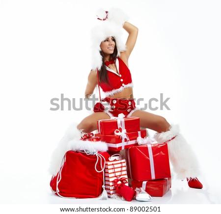 Christmas girl with gifts - stock photo
