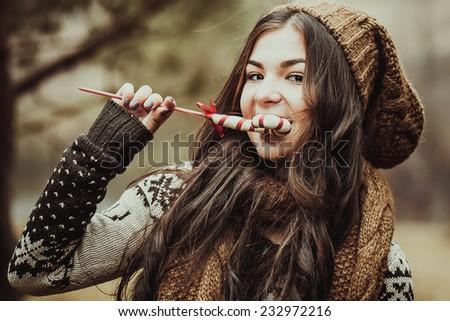 Christmas girl with sweets - stock photo