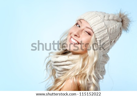 christmas girl, young beautiful smiling and give a wink over blue background - stock photo