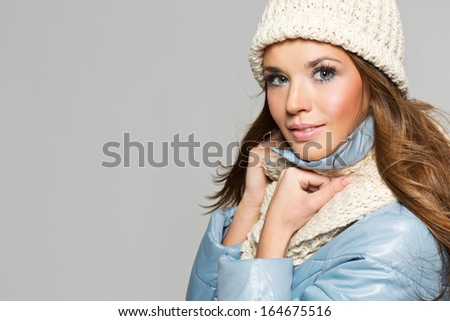 Christmas girl, young beautiful smiling over gray background - stock photo