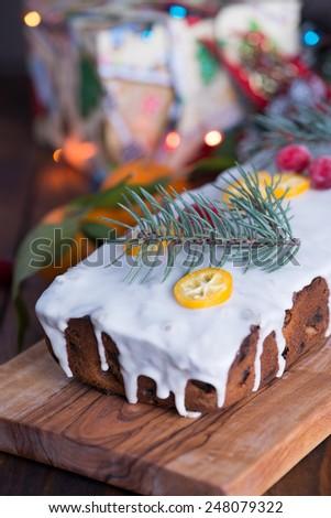 Christmas glazed cake with berries and kumquats - stock photo