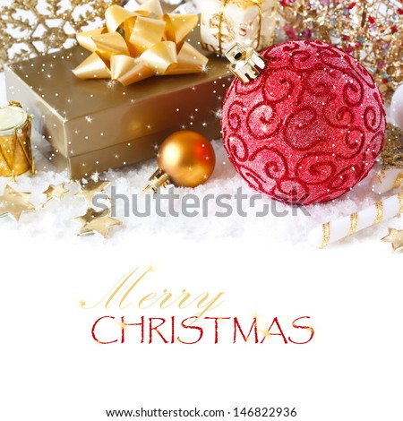 Christmas gold and red decoration on the snow. - stock photo