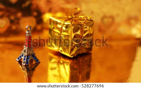 Christmas gold box and figurine of Eiffel tower